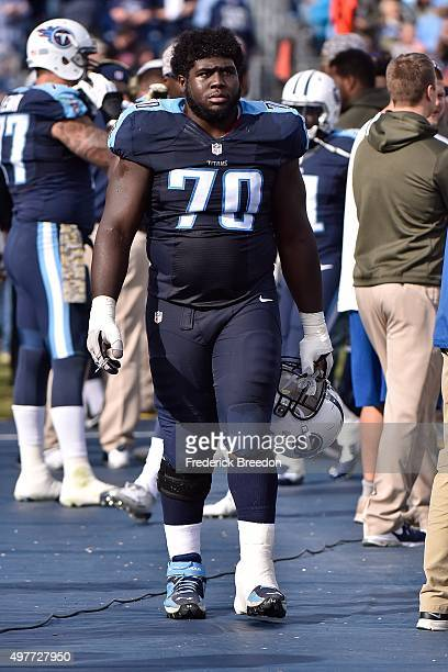 Chance Warmack of the Tennessee Titans watches from the sideline during a game against the Carolina Panthers at Nissan Stadium on November 15 2015 in...