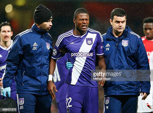 Chancel Mbemba of Anderlecht is given assistance during the UEFA Champions League Group D match between Arsenal FC and RSC Anderlecht at Emirates...