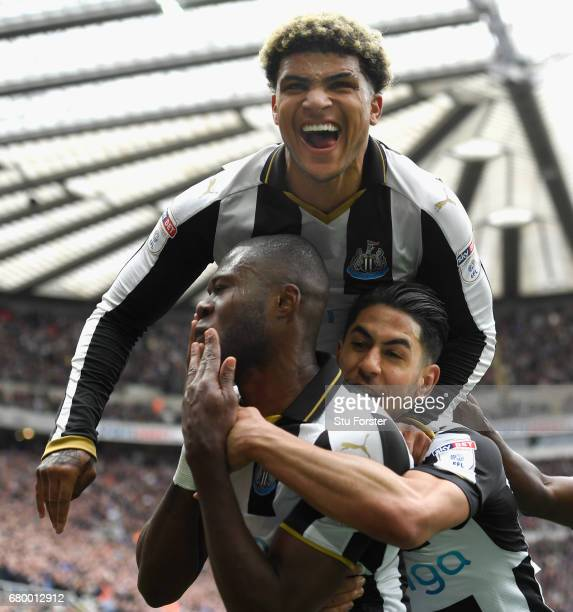 Chancel Mbemba of Newcastle celebrates after scoring the second goal with Deandre Yedlin and Ayoze Perez during the Sky Bet Championship match...