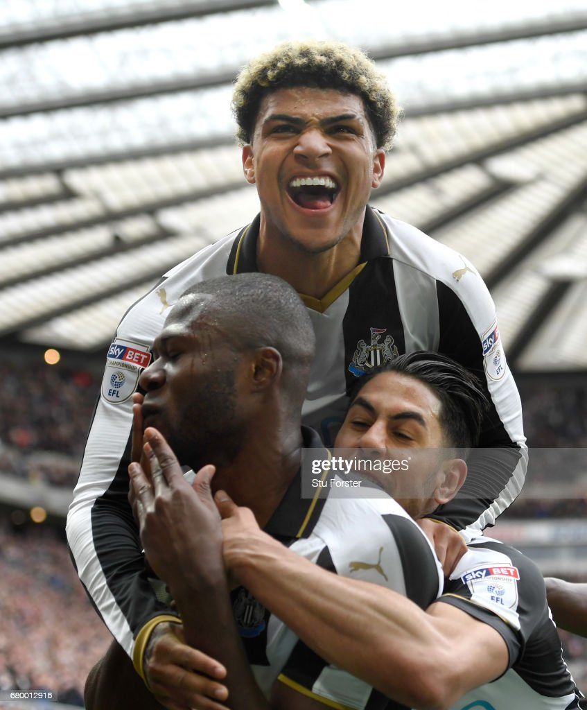 Chancel Mbemba of Newcastle celebrates after scoring the second goal with Deandre Yedlin (top) and Ayoze Perez during the Sky Bet Championship match between Newcastle United and Barnsley at St James' Park on May 7, 2017 in Newcastle upon Tyne, England.