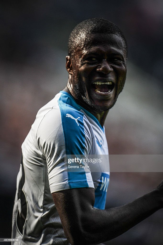 <a gi-track='captionPersonalityLinkClicked' href=/galleries/search?phrase=Chancel+Mbemba&family=editorial&specificpeople=11098951 ng-click='$event.stopPropagation()'>Chancel Mbemba</a> of Newcastle laughs on his debut during the Pre Season Friendly between Newcastle United and Borussia Monchengladbach at St.James Park on August 1, 2015, in Newcastle upon Tyne, England.