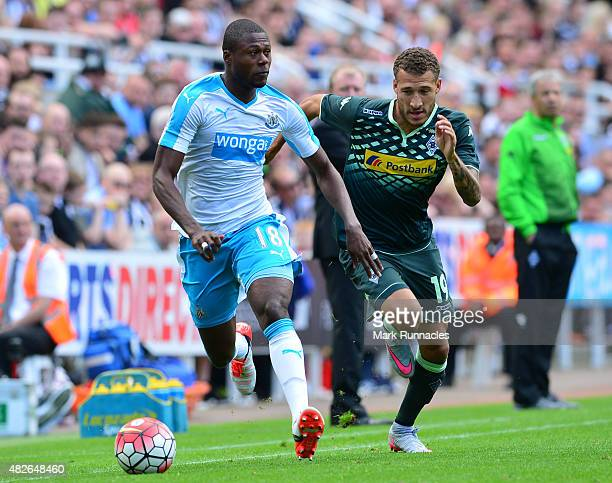 Chancel Mbemba of Newcastle takes on Fabian Johnson of Borussia Moenchengladbach during the Pre Season Friendly between Newcastle United and Borussia...