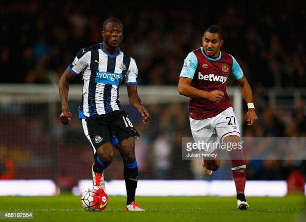 Chancel Mbemba of Newcastle United is closed down by Dimitri Payet of West Ham United during the Barclays Premier League match between West Ham...