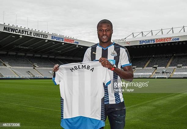 Chancel Mbemba poses for photographs and holds up a named shirt at StJames Park on July 24 2015 in Newcastle upon Tyne England