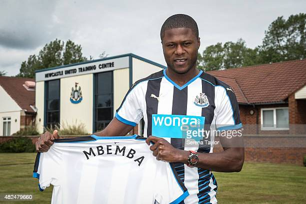 Chancel Mbemba poses for photographs holding a named club shirt at the Newcastle United Training Centre on July 24 in Newcastle upon Tyne England