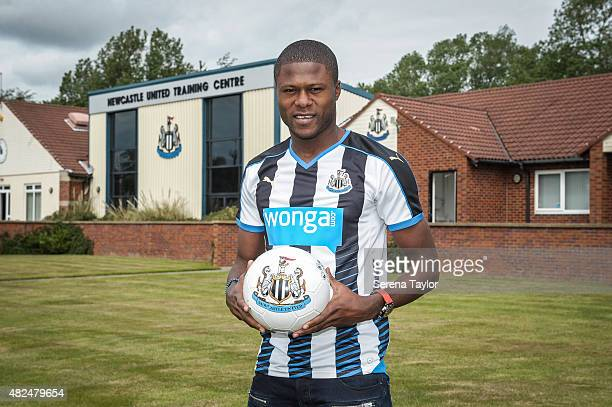Chancel Mbemba poses for photographs holding a Newcastle United Ball at the Newcastle United Training Centre on July 24 in Newcastle upon Tyne England