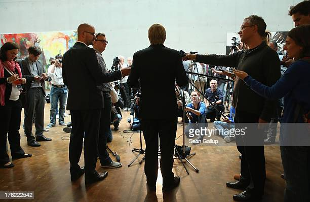 Chancellery Minister Ronald Pofalla speaks briefly to the media before testifying at a hearing of the parliamentary control commission of the...