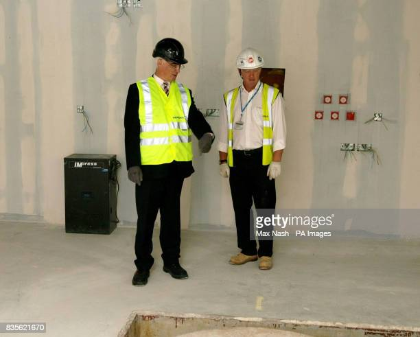 Chancellor Alistair Darling and projects manager Steve Eames during a visit to see the linear accelerator in the new radio therapy room at St Bart's...