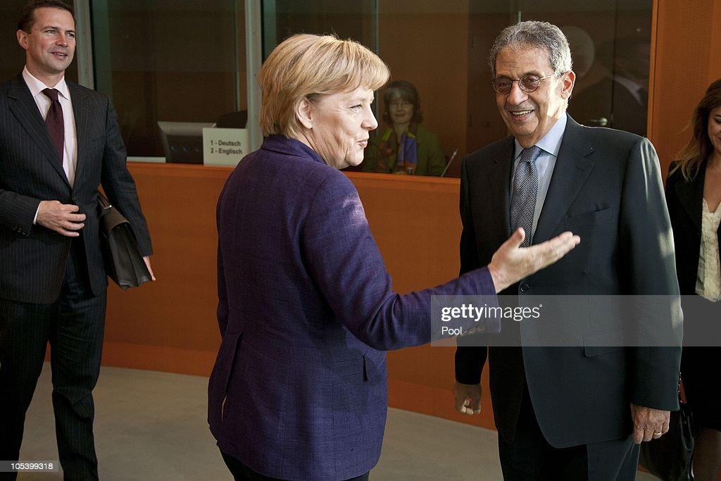 Chancellor <a gi-track='captionPersonalityLinkClicked' href=/galleries/search?phrase=Angela+Merkel&family=editorial&specificpeople=202161 ng-click='$event.stopPropagation()'>Angela Merkel</a> and German government spokesman <a gi-track='captionPersonalityLinkClicked' href=/galleries/search?phrase=Steffen+Seibert&family=editorial&specificpeople=2134117 ng-click='$event.stopPropagation()'>Steffen Seibert</a> (L) welcome Amre Moussa, Secretary General of the League of Arab States, for a meeting at the Chancellery (Bundeskanzleramt) on October 14, 2010 in Berlin, Germany.