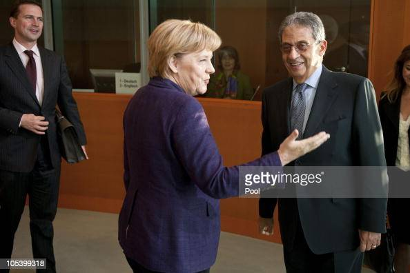 Chancellor Angela Merkel and German government spokesman Steffen Seibert welcome Amre Moussa Secretary General of the League of Arab States for a...