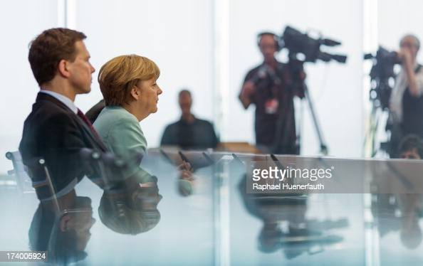 Chancellor Angela Merkel and German government spokesman Steffen Seibert speaks to the press on July 19 2013 in Berlin Germany Merkel holds her last...