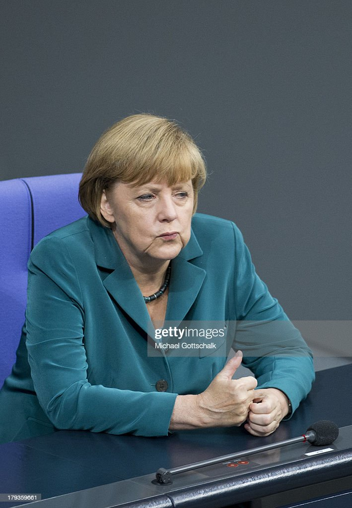 Chancellor <a gi-track='captionPersonalityLinkClicked' href=/galleries/search?phrase=Angela+Merkel&family=editorial&specificpeople=202161 ng-click='$event.stopPropagation()'>Angela Merkel</a> (CDU) attends the debate in response to the report prepared by the NSU Bundestag investigation commission on September 2, 2013 in Berlin, Germany. The report details shortcomings by law enforcement in the investigations of the NSU neo-Nazi murder series and recommendations for improvements. A trio of neo-Nazis calling themselves the National Socialist Underground, or NSU, murdered nine immigrants and one policewoman between 2000 and 2007 in a case that is the biggest scandal over law enforcement in recent German history.