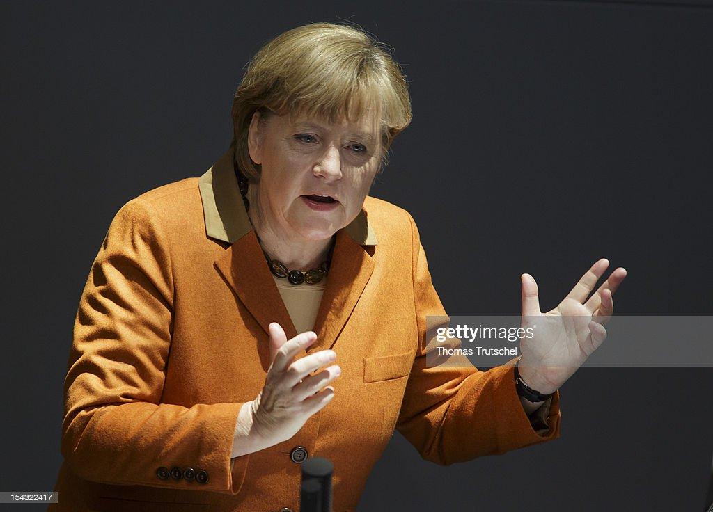 Chancellor <a gi-track='captionPersonalityLinkClicked' href=/galleries/search?phrase=Angela+Merkel&family=editorial&specificpeople=202161 ng-click='$event.stopPropagation()'>Angela Merkel</a> gives a government declaration on the European Council in Brussels at Reichstag, the seat of the German Parliament (Bundestag), on October 18, 2012 in Berlin, Germany. European Union leaders are expected to focus on economic and monetary policies as they gather for the two-day Autumn meeting starting today in Brussels.