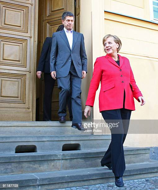 Chancellor Angela Merkel of the Christian Democratic Union party and her husband Joachim Sauer leave their home to cast their ballots for German...