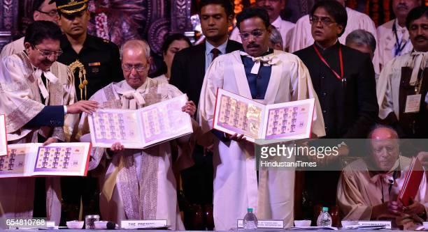 Chancellor C Vidyasagar Rao President Pranab Mukherjee Vinod Tawde and Dr M S Swaminathan during the launch of postal stamp at Mumbai University on...