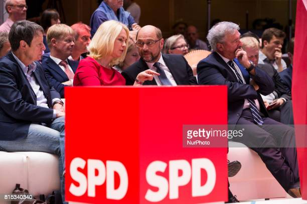 Chancellor Candidate and Chairman of the Social Democratic Party Martin Schulz chats with President of MeklenburgVorpommern Manuela Schweisg during...