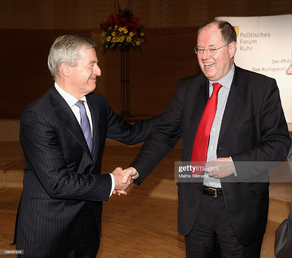 Chancellor candidate of the German Social Democrats (SPD) <a gi-track='captionPersonalityLinkClicked' href=/galleries/search?phrase=Peer+Steinbrueck&family=editorial&specificpeople=209110 ng-click='$event.stopPropagation()'>Peer Steinbrueck</a> and Deutsche Bank co-Chairman <a gi-track='captionPersonalityLinkClicked' href=/galleries/search?phrase=Juergen+Fitschen&family=editorial&specificpeople=3093173 ng-click='$event.stopPropagation()'>Juergen Fitschen</a> chat at a podium discussion at the Ruhr Initiative Circle (Initiativkreis Ruhr) congress on December 17, 2012 in Essen, Germany. German police recently raided the headquarters of Deutsche Bank and are investigating Fitschen and 24 other Deutsche Bank employees on suspicion of money laundering and tax evasion related to the trading of carbon emissions certificates.