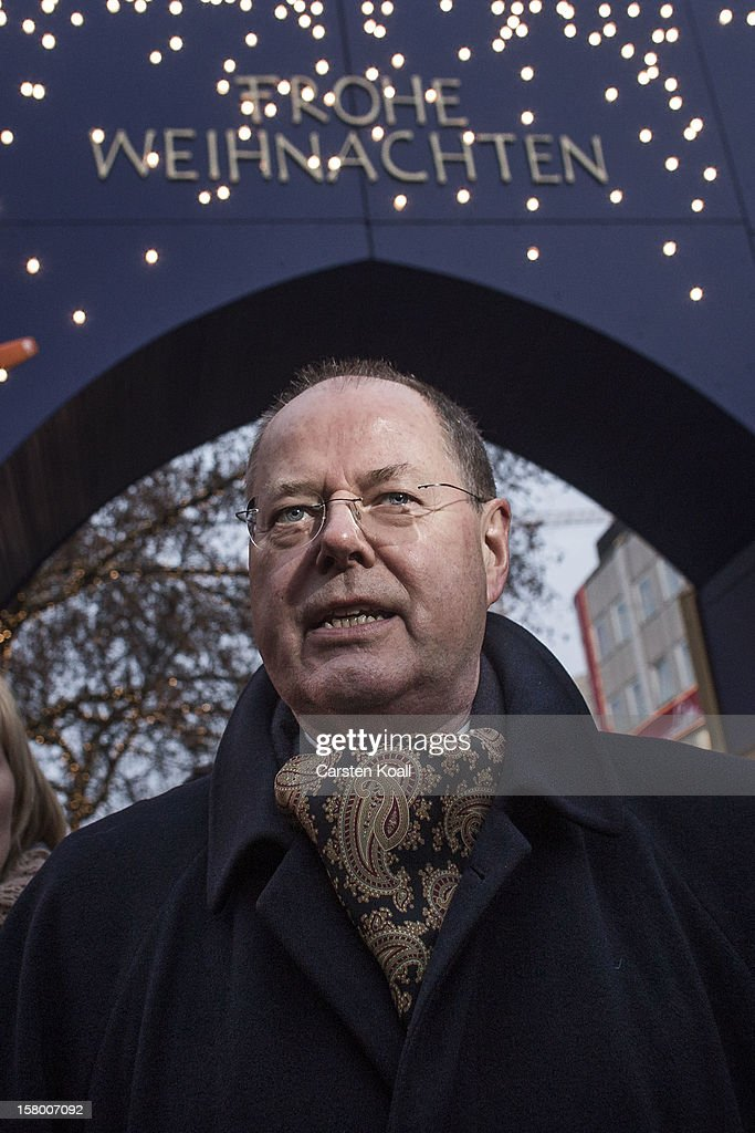 Chancellor Candidate Peer Steinbrueck attend the annual Christmas market the day before the SPD federal party convention on December 8, 2012 in Hanover, Germany. The SPD will convene to set its policy course for the next year and to celebrate Steinbrueck, who will run for chancellor in elections set for 2013.