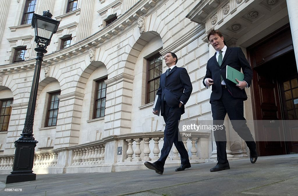 Chancellor George Osborne (L) and Chief Secretary of the Treasury Danny Alexander leave The Treasury for Parliament on December 3, 2014 in London, England. Chancellor of the Exchequer George Osborne will deliver his Autumn statement to Parliament today.