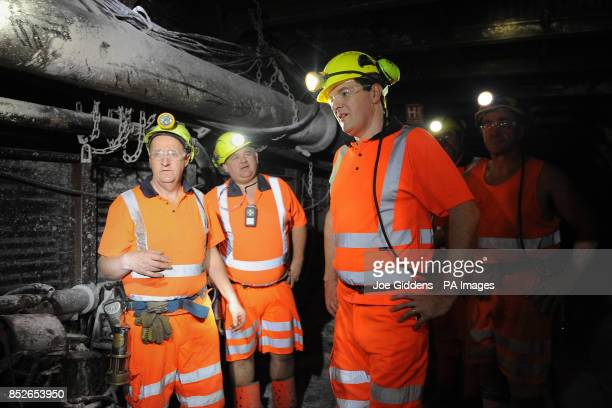 Chancellor George Osborne down the mineshaft during his visit to Thoresby Colliery Nottinghamshire