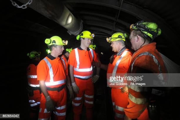Chancellor George Osborne is given a tour of the mineshaft by chief executive of UK Coal Kevin McCullough production undermanager Ian Hunter and...