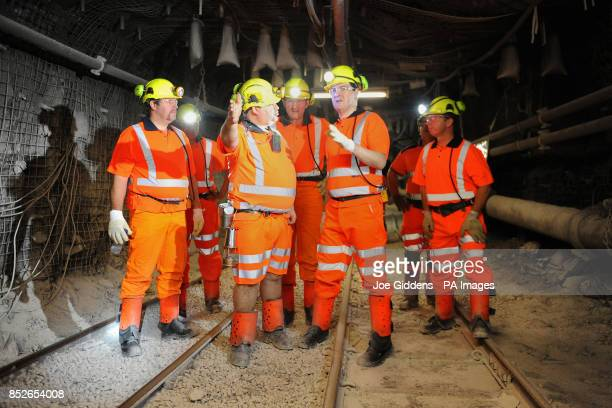 Chancellor George Osborne is given a tour of the mineshaft by production undermanager Ian Hunter during his visit to Thoresby Colliery Nottinghamshire