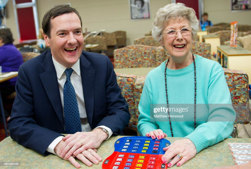 Chancellor George Osborne laughs during a visit to Castle Bingo to see how it has been affected by the budget on March 25, 2014 in Cardiff, Wales. In the Chancellor's budget statement last week he announced a cut in tax on the profits of Bingo halls from 20 per cent to 10 per cent.