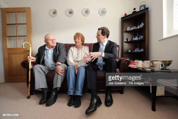 Chancellor George Osborne meets retired miner John Carlin and widow of a miner Margaret Clarke to discuss the miners fuel allowance in Hucknall...