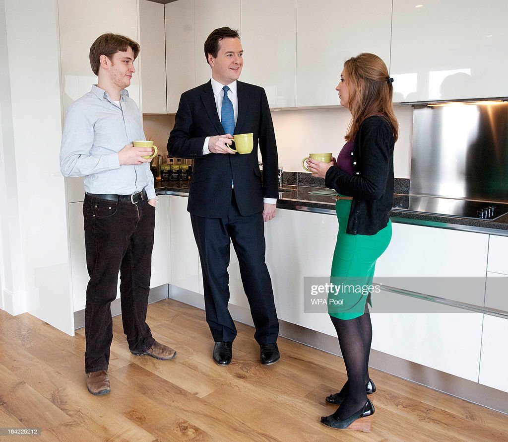Chancellor George Osborne (C) meets with Emily Sandercock (R) and Rick Newton at the Berkeley Homes Royal Arsenal Riverside development in Woolwich, where they have recently bought an apartment, on March 21, 2013 in south east London, England. The Chancellor of the Exchequer visited home-buyers at a housing development site the day after he announced in his Budget speech the government's measures for assisting first-time buyers and existing home-owners in moving up the property ladder, with a GBP £3.5 billion investment in government loans to financially stretched homebuyers and GBP £12 billion towards a scheme to increase availability of mortgages to first-time buyers unable to afford a large deposit. Homebuyers will be able to borrow up to 20% per cent of the value of most new-build properties interest-free for five years.