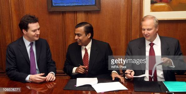Chancellor George Osborne Mukesh Ambani Chairman and Managing Director of Reliance Industries and Robert Dudley CEO of BP during a signing ceremony...