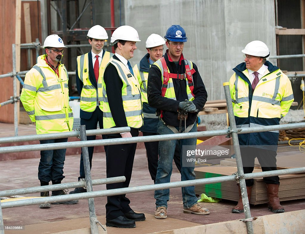 Chancellor George Osborne (3rd L) speaks to construction workers during a visit to the Berkeley Homes Royal Arsenal Riverside development in Woolwich, on March 21, 2013 in south east London, England. The Chancellor of the Exchequer visited construction workers and home-buyers at the housing development site the day after he announced in his Budget speech the government's measures for assisting first-time buyers and existing home-owners in moving up the property ladder, with a GBP £3.5 billion investment in government loans to financially stretched home-buyers and GBP £12 billion towards a scheme to increase availability of mortgages to first-time buyers unable to afford a large deposit. Homebuyers will be able to borrow up to 20% per cent of the value of most new-build properties interest-free for five years.