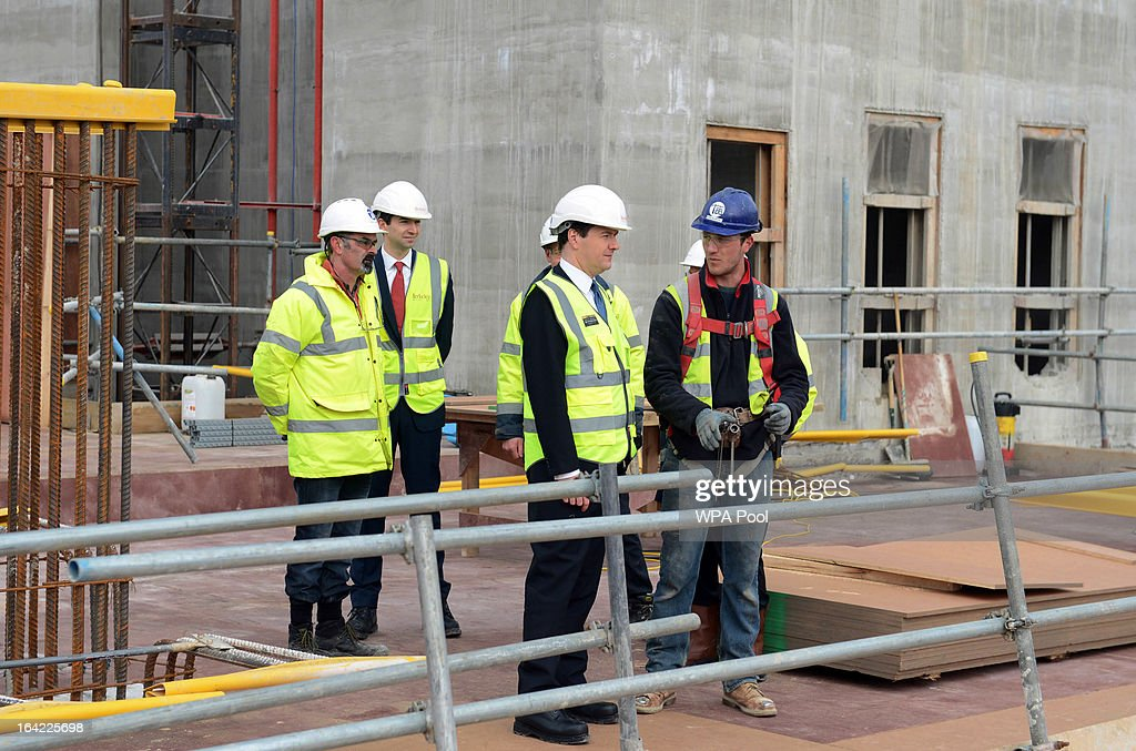 Chancellor George Osborne (C) speaks to construction workers during a visit to the Berkeley Homes Royal Arsenal Riverside development in Woolwich, on March 21, 2013 in south east London, England. The Chancellor of the Exchequer visited construction workers and home-buyers at the housing development site the day after he announced in his Budget speech the government's measures for assisting first-time buyers and existing home-owners in moving up the property ladder, with a GBP £3.5 billion investment in government loans to financially stretched home-buyers and GBP £12 billion towards a scheme to increase availability of mortgages to first-time buyers unable to afford a large deposit. Homebuyers will be able to borrow up to 20% per cent of the value of most new-build properties interest-free for five years.