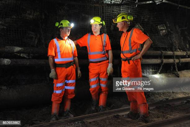 Chancellor George Osborne talks to chief executive of UK Coal Kevin McCullough and communications director Andrew McKintosh down the mineshaft during...