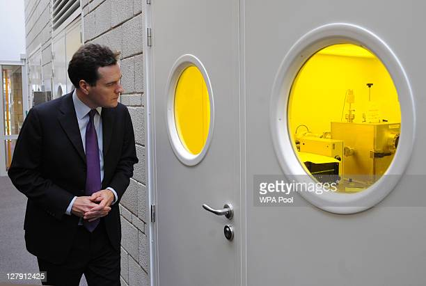 Chancellor George Osborne tours science laboratories being used to research the use of Graphene during a visit to the University of Manchester on...