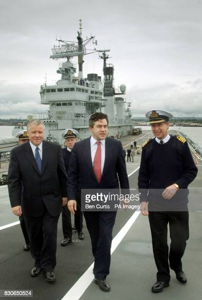 Chancellor Gordon Brown and Armed Forces Minister Adam Ingram depart after a tour of HMS Ark Royal by Commander David Snelson as it sits at anchor...