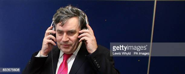 Chancellor Gordon Brown listens to electronic music while visiting youth club members at the Stowe Centre in London