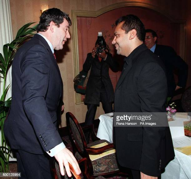 Chancellor Gordon Brown meets Asian businessman Shami Ahmed founder of Joe Bloggs clothing during a business breakfast at London's Regency Hotel...