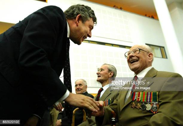 Chancellor Gordon Brown meets exserviceman Sandy English at the Veteran's Day service and presentation of armed forces badges at Adam Smith College...