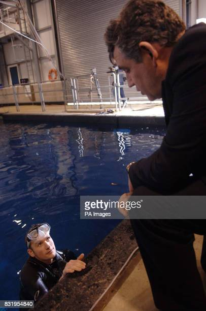 Chancellor Gordon Brown speaks to an underwater cameraman after opening Europe's only studio based permanently filled underwater filming stage at...