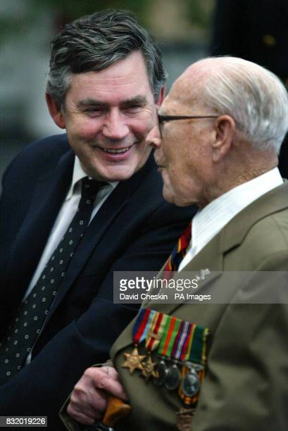 Chancellor Gordon Brown talks to exserviceman Sandy English at the Veteran's Day service and presentation of armed forces badges at Adam Smith...