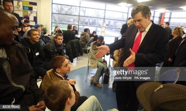 Chancellor Gordon Brown talks to youth club members during his visit to the Stowe Youth Centre in London