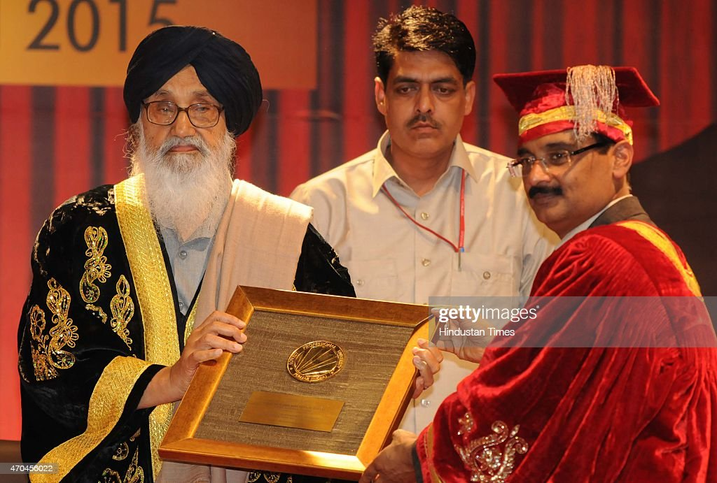 Chancellor LPU Ashok Mittal honouring the chief minister <a gi-track='captionPersonalityLinkClicked' href=/galleries/search?phrase=Parkash+Singh+Badal&family=editorial&specificpeople=3634862 ng-click='$event.stopPropagation()'>Parkash Singh Badal</a> during the 4th convocation at Lovely Professional University on April 20, 2015 in Jalandhar, India.