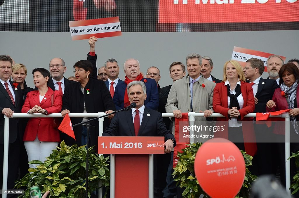 Chancellor of Austria Werner Faymann delivers a speech during a rally to mark May Day, International Workers' Day, in front of municipal building in Vienna, capital city of Austria on May 1, 2016. His opponents interrupted Faymann's speech.