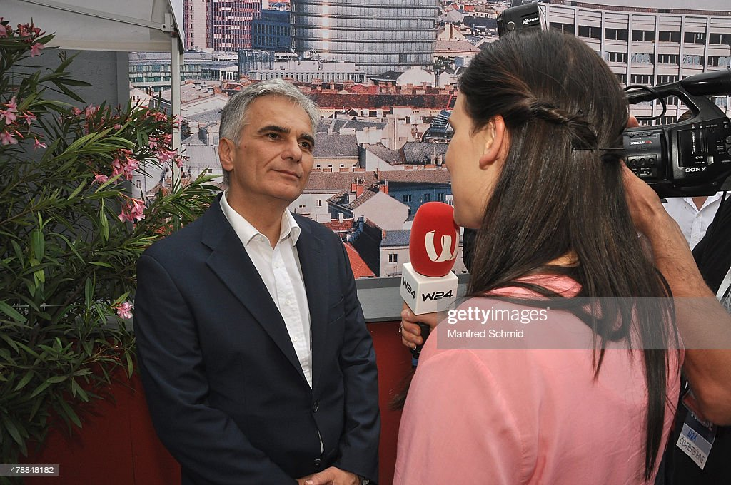Chancellor of Austria <a gi-track='captionPersonalityLinkClicked' href=/galleries/search?phrase=Werner+Faymann&family=editorial&specificpeople=4101130 ng-click='$event.stopPropagation()'>Werner Faymann</a> poses at Donauinselfest DIF 2015 on June 27, 2015 in Vienna, Austria.