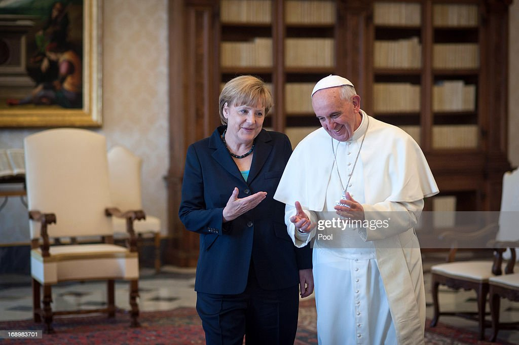 Chancellor of Germany <a gi-track='captionPersonalityLinkClicked' href=/galleries/search?phrase=Angela+Merkel&family=editorial&specificpeople=202161 ng-click='$event.stopPropagation()'>Angela Merkel</a> chats with <a gi-track='captionPersonalityLinkClicked' href=/galleries/search?phrase=Pope+Francis&family=editorial&specificpeople=2499404 ng-click='$event.stopPropagation()'>Pope Francis</a> after their meeting in his private library at the Vatican on May 18, 2013 in Vatican City, Vatican.