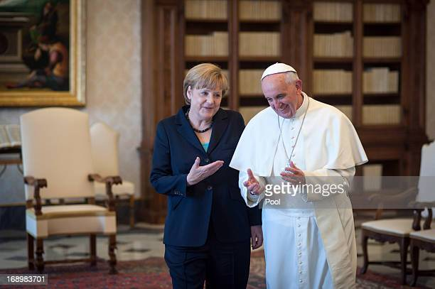 Chancellor of Germany Angela Merkel chats with Pope Francis after their meeting in his private library at the Vatican on May 18 2013 in Vatican City...