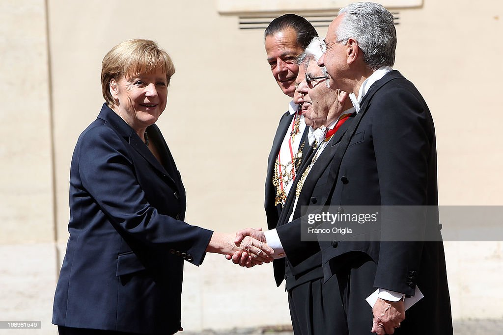Chancellor of Germany <a gi-track='captionPersonalityLinkClicked' href=/galleries/search?phrase=Angela+Merkel&family=editorial&specificpeople=202161 ng-click='$event.stopPropagation()'>Angela Merkel</a> greets Papal Gentlemen as she arrives at the Cortile di San Damaso for a visit with Pope Francis on May 18, 2013 in Vatican City, Vatican.