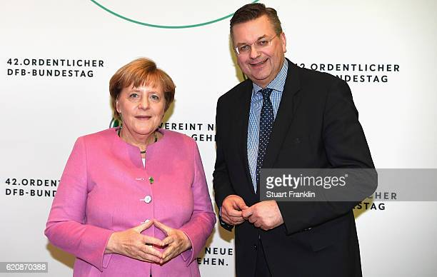Chancellor of Germany Angela Merkel poses for a picture with DFB President Reinhard Grindel during the ceremonial act of the 42nd DFB Bundestag at...