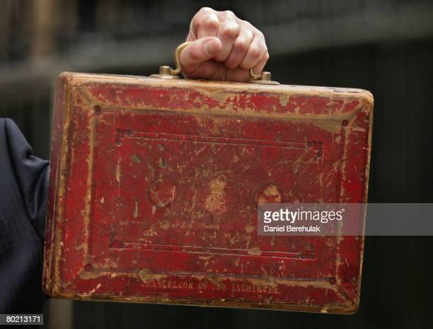 Chancellor of the Exchequer Alistair Darling holds up the red box outside number 11 Downing Street on March 12 2008 in London England The Chancellor...