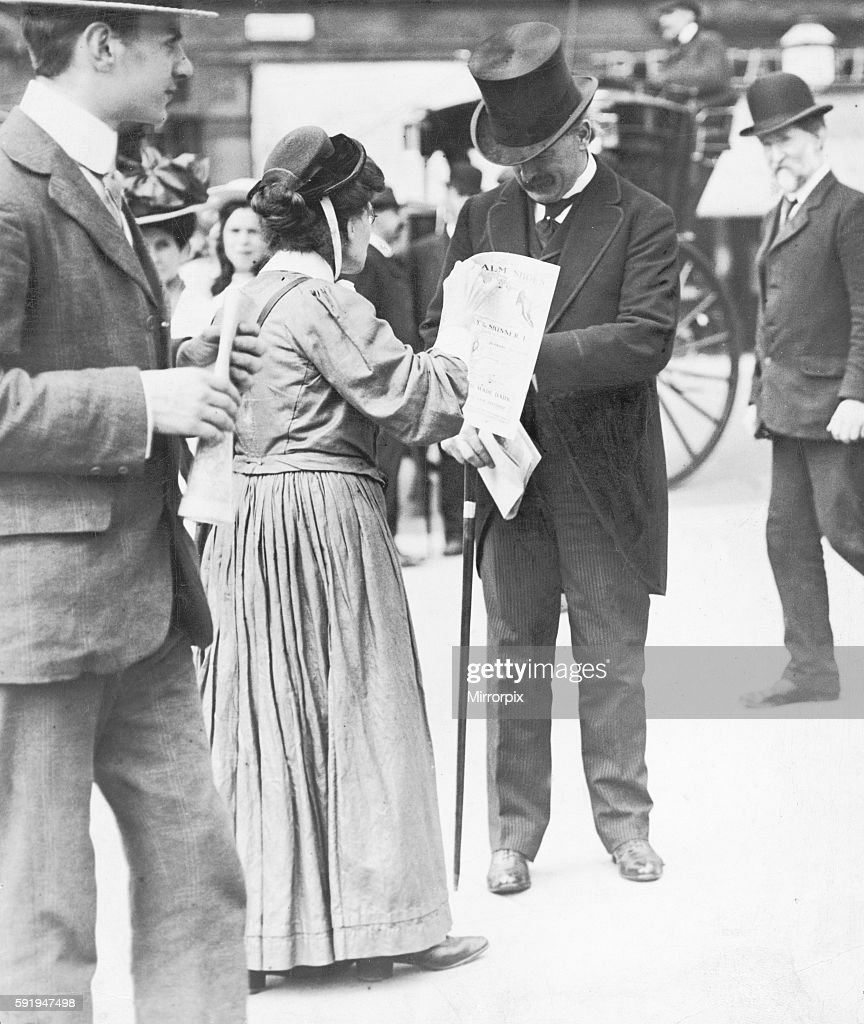 Chancellor Of The Exchequer David Lloyd George Seen Here Buying A Votes For  Women' Pamphlet